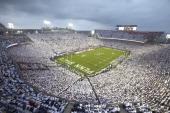 Overall view of Penn State fans wearing all white in stands during 'White Out' game vs Ohio State at Beaver Stadium University Park PA CREDIT Simon...