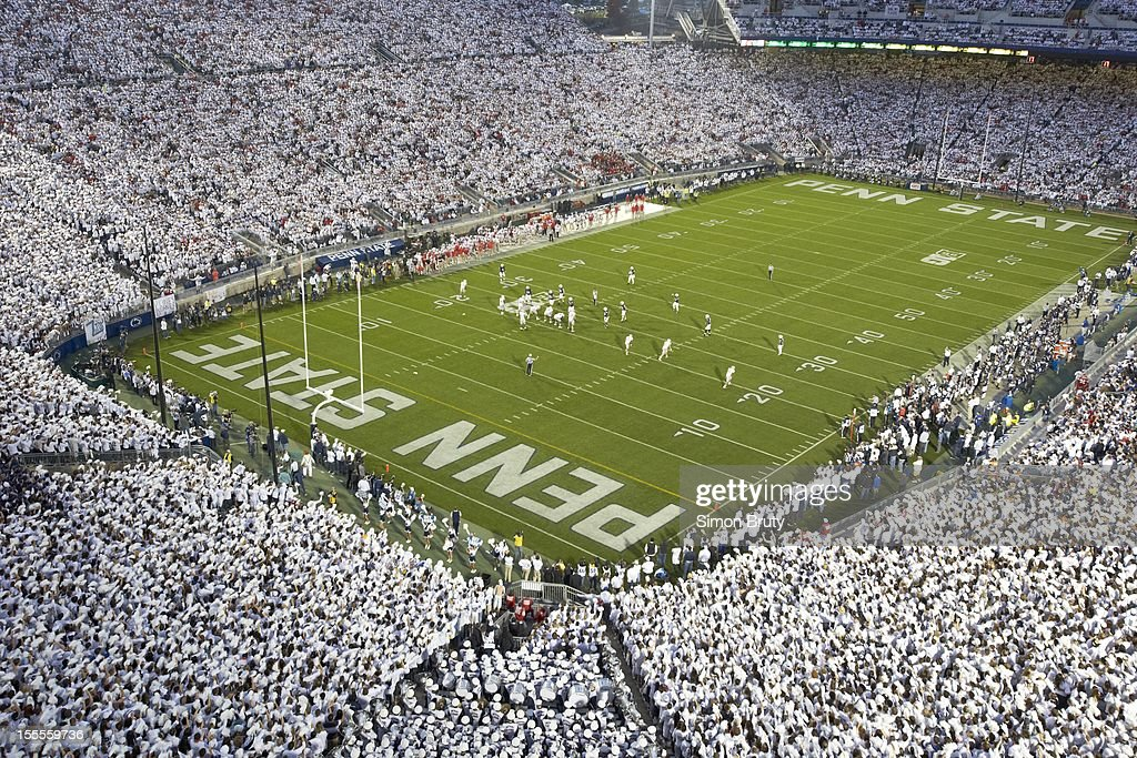 Overall view of Penn State fans wearing all white in stands during 'White Out' game vs Ohio State at Beaver Stadium. Simon Bruty F5 )