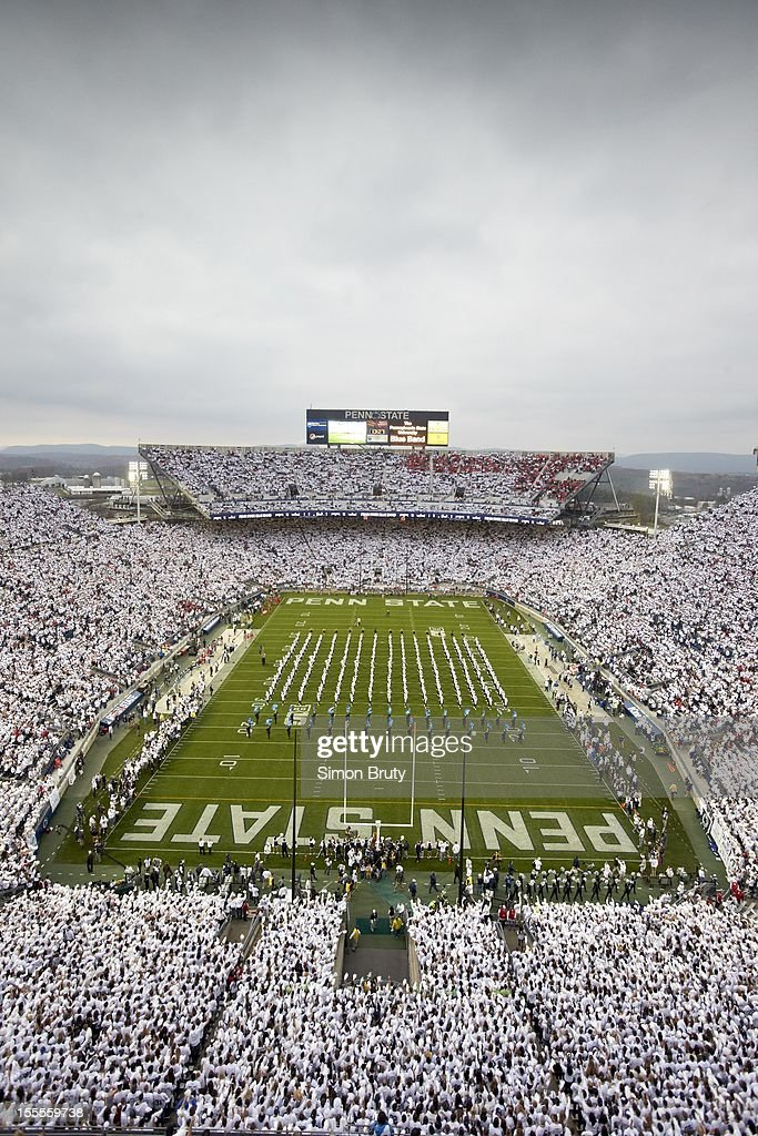 Overall view of Penn State fans wearing all white in stands during 'White Out' game vs Ohio State at Beaver Stadium. Simon Bruty F50 )