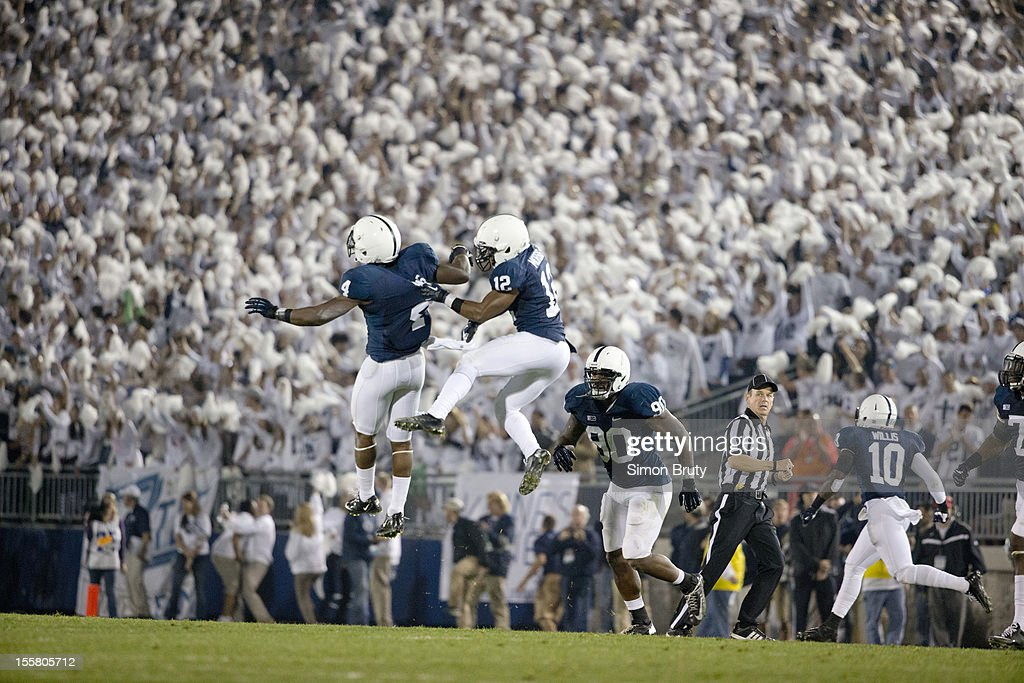 Penn State Adrian Amos (4) and Stephon Morris (12) victorious after making interception vs Ohio State at Beaver Stadium. Simon Bruty F157 )