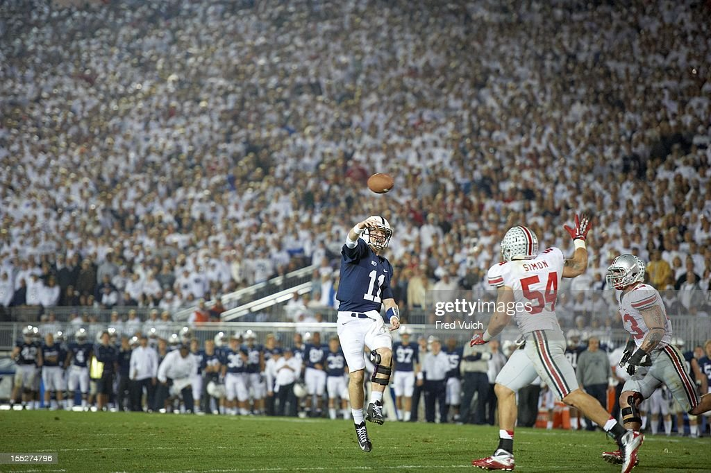 Penn State QB Matthew McGloin (11) in action, passing vs Ohio State at Beaver Stadium. Fred Vuich F174 )