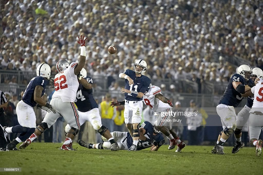 Penn State QB Matthew McGloin (11) in action, passing vs Ohio State at Beaver Stadium. Simon Bruty F49 )