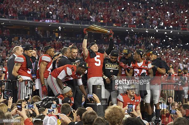 Playoff National Championship Ohio State Jeff Heuerman victorious holding National Championship trophy after winning game vs Oregon at ATT Stadium...