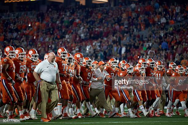 Playoff National Championship View of Clemson head coach Dabo Swinney and players walking onto field with arms locked before game vs Alabama at...