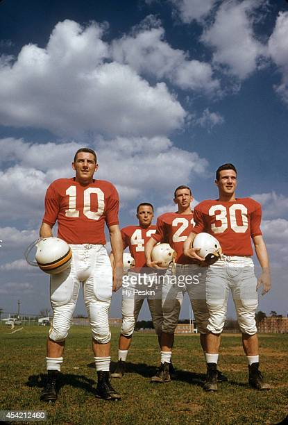 Portrait of Maryland offense QB Frank Tamburello fullback Tom Selep right halfback Ed Vereb and left halfback Howie Dare during spring practice...