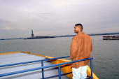 Rear view of Alcorn State QB Steve McNair riding on Staten Island Ferry in the New York Harbor View of Statue of Liberty in background New York City...