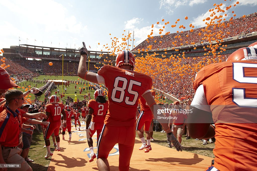 Rear view of Clemson players after touching Howard rock for luck before game vs Florida State at Memorial Stadium. Simon Bruty F38 )