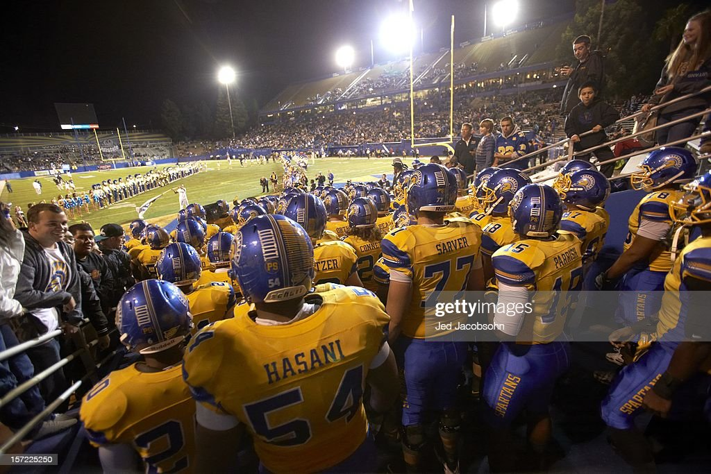 Rear view of San Jose State players taking field before game vs BYU at Spartan Stadium. Jed Jacobsohn F308 )