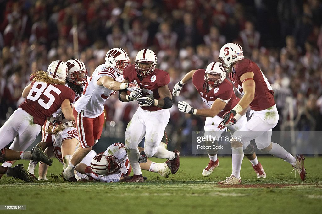 Stanford Stepfan Taylor (33) in action, rushing vs Wisconsin Ethan Armstrong (36) at Rose Bowl Stadium. Robert Beck F144 )