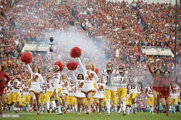 Rose Bowl USC cheerleaders and players taking field before game vs Penn State at Rose Bowl Pasadena CA CREDIT Robert Beck