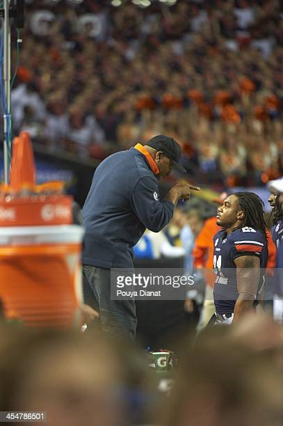 SEC Championship Auburn alum former NFL and MLB player Bo Jackson talking to Tre Mason after game vs Missouri at Georgia Dome Atlanta GA CREDIT Pouya...