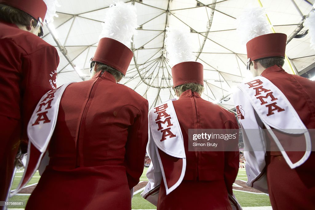 Rear view of Alabama marching band members on sidelines during game vs Georgia at Georgia Dome. Simon Bruty F66 )