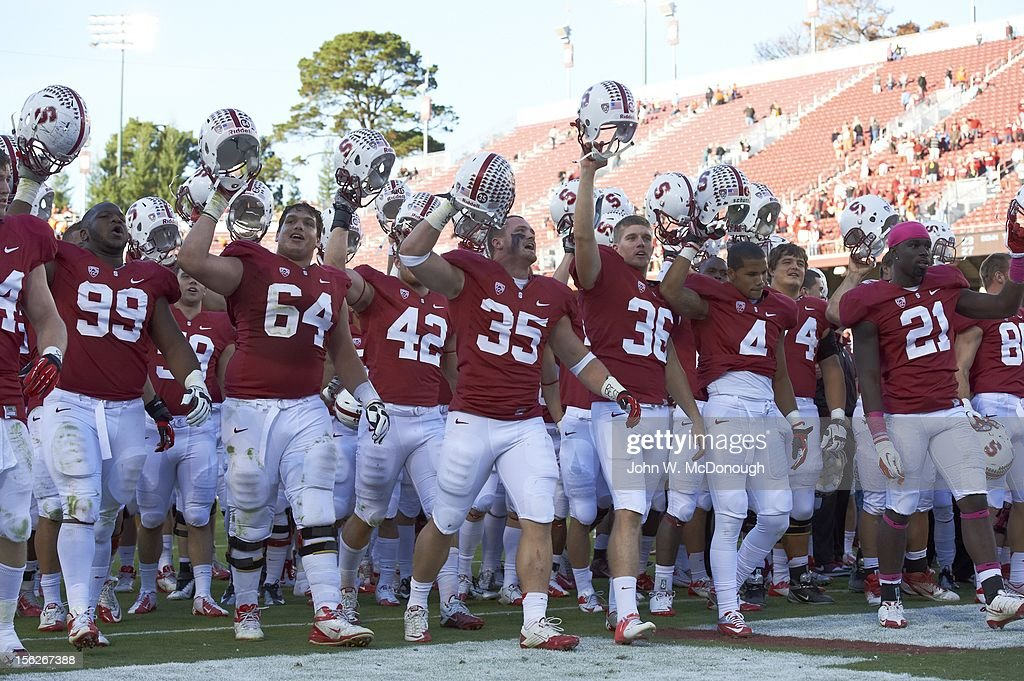 Stanford Terrence Stephens (99), Sam Schwartzstein (64), Alex Debniak (42), Jarek Lancaster (35), Daniel Zychlinski (36), Drew Terrell (4), and Jamal-Rashad Patterson (21) victorious on field before game vs Oregon State at Stanford Stadium. John W. McDonough F172 )