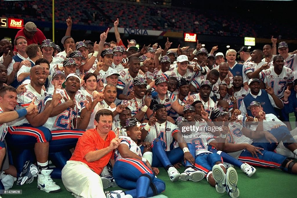 Sugar Bowl, Florida coach <a gi-track='captionPersonalityLinkClicked' href=/galleries/search?phrase=Steve+Spurrier&family=editorial&specificpeople=228031 ng-click='$event.stopPropagation()'>Steve Spurrier</a> victorious with team during portrait after winning national championship game vs Florida State, New Orleans, LA 1/2/1997