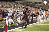 Texas Tech Michael Crabtree in action rushing for touchdown after making game winning catch vs Texas Curtis Brown and Earl Thomas during final...