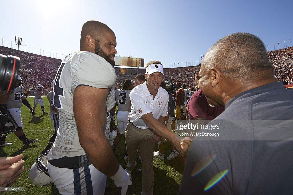 USC coach Lane Kiffin shaking hands after game vs Utah State at Los Angeles Memorial Coliseum. John W. McDonough F6 )