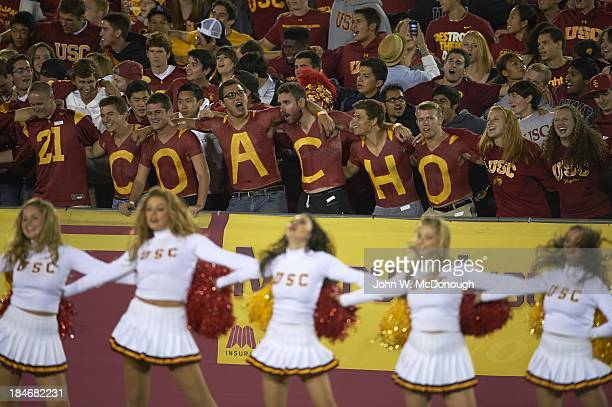 USC fans in stands with letters painted on chests during game vs Arizona at Los Angeles Memorial Coliseum Los Angeles CA CREDIT John W McDonough