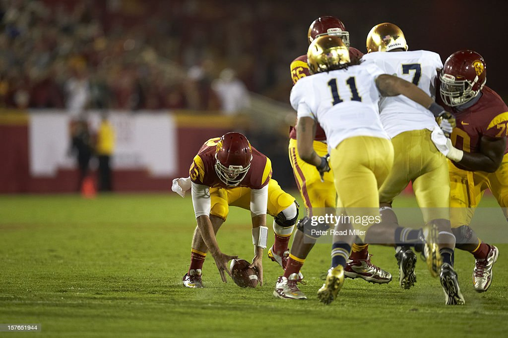 Max Wittek (13) in action, making fumble vs Notre Dame at Los Angeles Memorial Coliseum. Peter Read Miller X155814 TK1 R1 F311 )