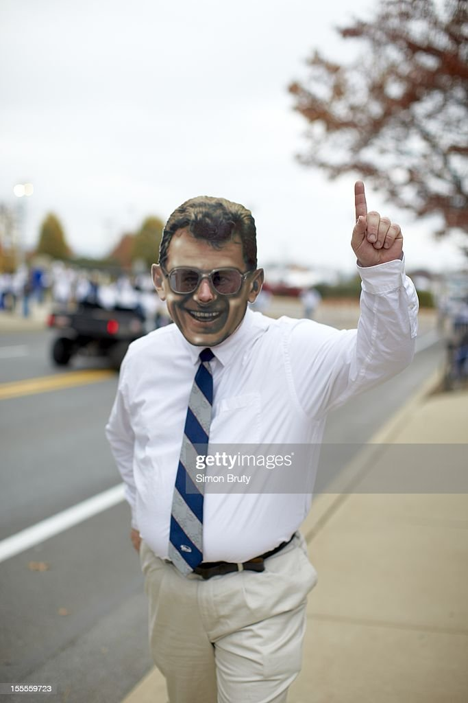 View of fan dressed as former Penn State coach Joe Paterno outside stadium before game vs Ohio State at Beaver Stadium. Simon Bruty F6 )