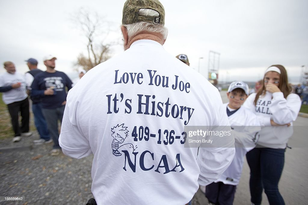 View of fan wearing shirt reading LOVE YOU JOE, IT'S HISTORY outside stadium before Penn State vs Ohio State game at Beaver Stadium. Simon Bruty F1 )