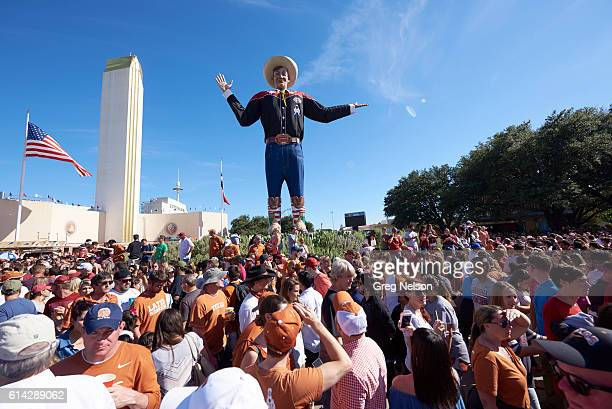 View of fans tailgating in front of Big Tex statue outside of Cotton Bowl before Texas vs Oklahoma game Dallas TX CREDIT Greg Nelson