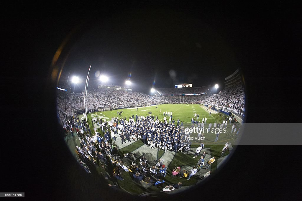 View of Penn State players singing alma mater after winning game vs Ohio State at Beaver Stadium. Fred Vuich F78 )
