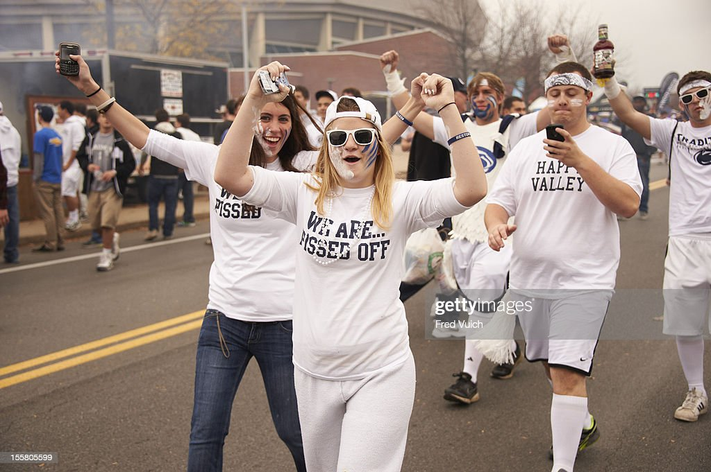 View of Penn States fans wearing WE ARE PISSED OFF t-shirts before game vs Ohio State outside of Beaver Stadium. Fred Vuich F94 )