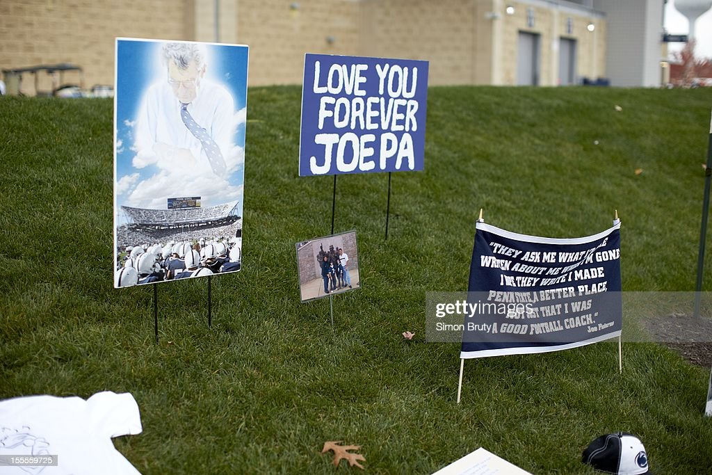 View of signs and pictures left by fans during memorial at former site of statue of coach Joe Paterno before Penn State vs Ohio State game at Beaver Stadium. Simon Bruty F31 )
