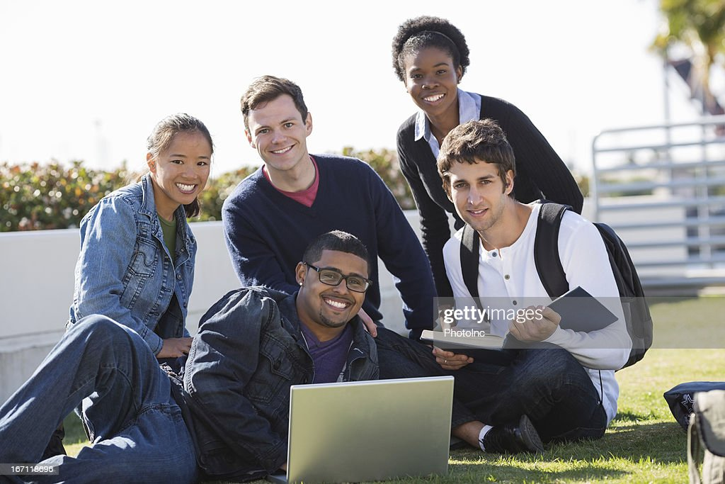 college Friends With Laptop And Book In Campus : Stock Photo