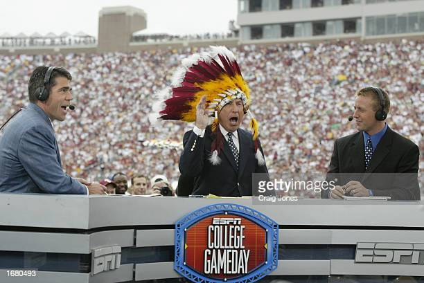 College GameDay announcer Lee Corso dons an FSU headress as coannouncers Chris Fowler and Kirk Herbstreit comment during the NCAA football game...