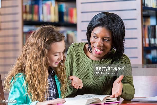 College girl volunteering to tutor elementary students after school