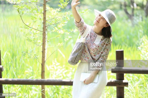College girls enjoying nature by raising their hands