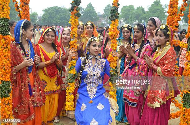 College girls wear traditional Punjabi dress riding 'Peeing' during the celebrations of Teej festival arranged at Khalsa College for Women on August...