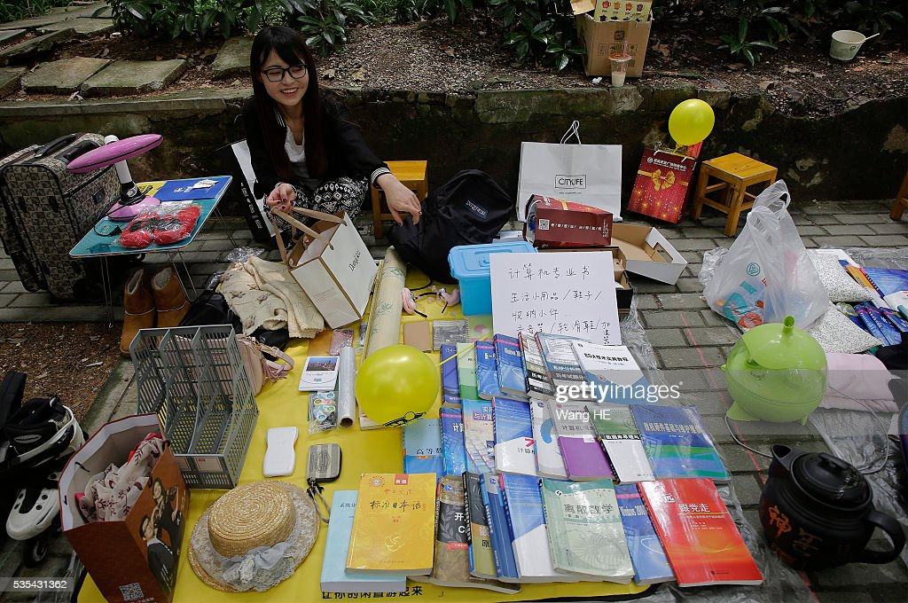 A College graduate sell their used textbooks, magazines, CD and other possessions on the campus of a university on May 29, 2016 in Wuhan, China. Graduates sell those things which are useless to them or are difficult to take them back home. on May 29, 2016 in Wuhan, China.