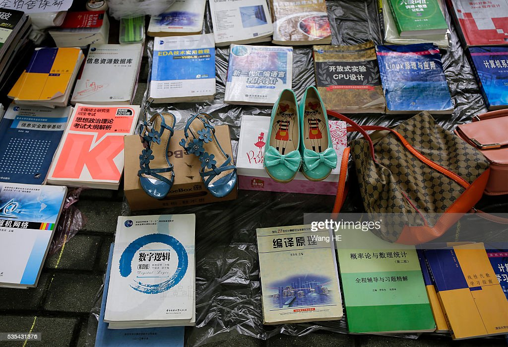 College graduates sell their used textbooks, magazines, CD and other possessions on the campus of a university on May 29, 2016 in Wuhan, China. Graduates sell those things which are useless to them or are difficult to take them back home. on May 29, 2016 in Wuhan, China.