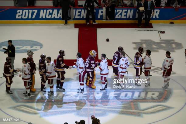 NCAA Frozen Four Aerial view of Denver players during postgame handshake with Minnesota Duluth players at United Center Chicago IL CREDIT David E...