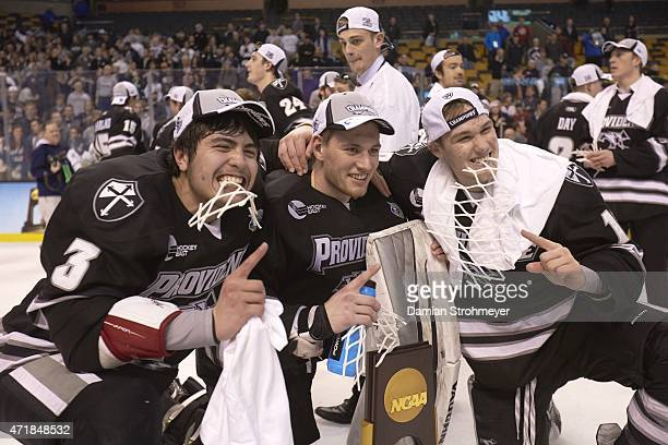 NCAA Frozen Four Providence John Gilmour Mark Jankowski and teammates victorious with trophy after winning game vs Boston at TD Garden Boston MA...