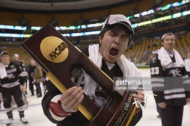 NCAA Frozen Four Providence John Gilmour victorious holding National Championship trophy after winning game vs Boston University at TD Garden Boston...