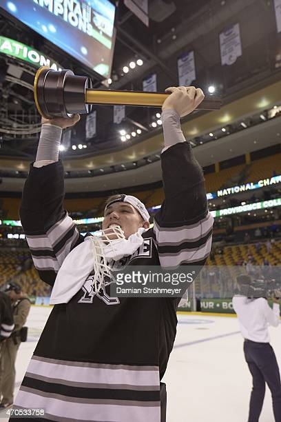 NCAA Frozen Four Providence Mark Jankowski victorious holding National Championship trophy after winning game vs Boston University at TD Garden...