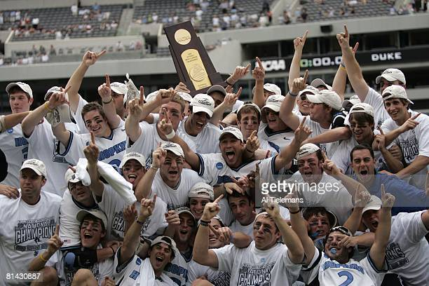 College Lacrosse NCAA finals Johns Hopkins victorious with trophy after winning championship game vs Duke Philadelphia PA 5/30/2005