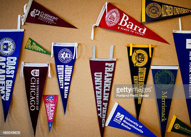 College pennants hanging on a bulletin board at the guidance office at Portland High School in Portland ME on Thursday October 15 2015