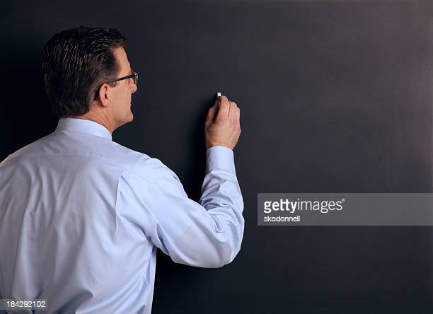 College Professor Against a Chalk Board