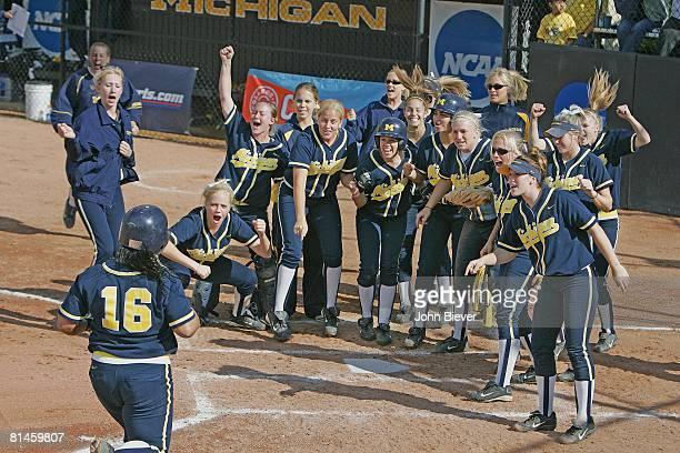 College Softball NCAA playoffs Michigan Samantha Findlay in action scoring run after hitting HR Washington Team victorious at home plate Ann Arbor MI...