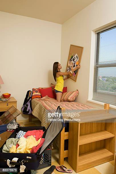 College student decorating her dorm room