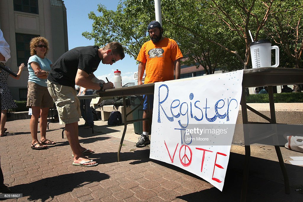 A college student fills out a form during a voter registration drive August 22 2008 in Denver Colorado The Democratic National Convention starts in...