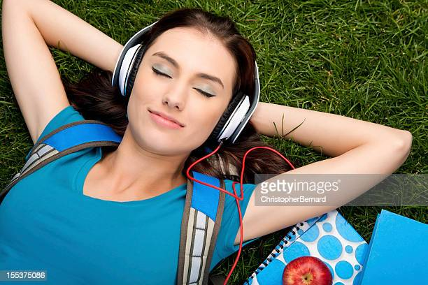 College student listening to music