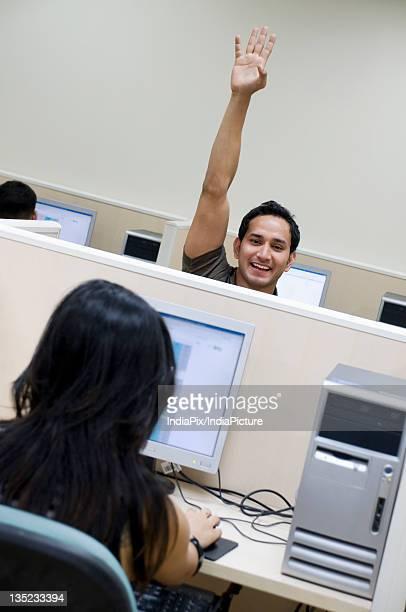 College student raising his hand