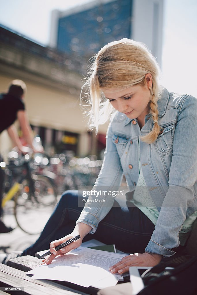 College student reading outdoor. : Stock Photo