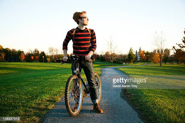 College student riding his bike on campus