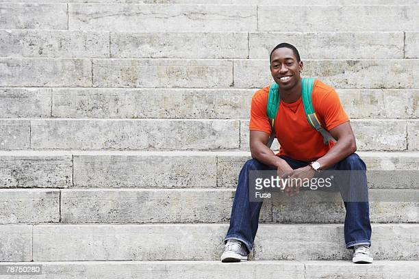 College Student Sitting on Steps